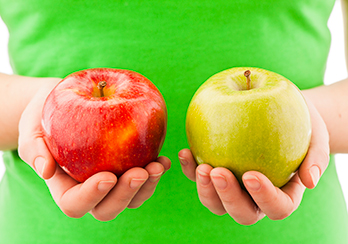 A red apple and a yellow apple