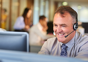 Man in a call center wearing phone headset