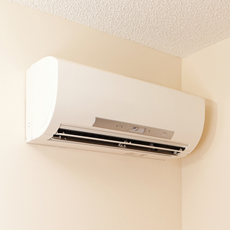 A ductless heating and cooling unit installed on a wall