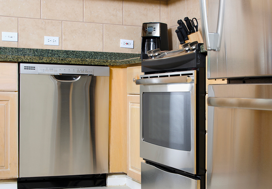 Stainless steel dishwasher and stove installed in a kitchen