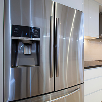 A side-by-side stainless steel refrigerator and freezer