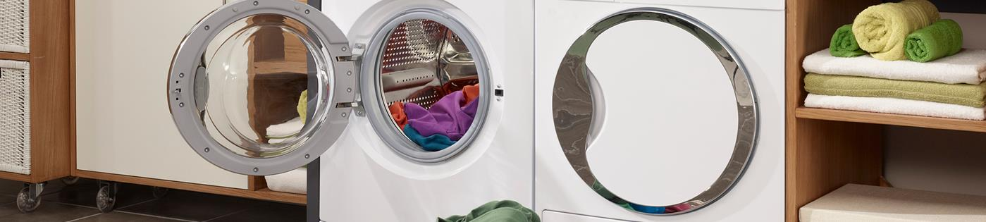 A front-loading washing machine with a basket of laundry in front
