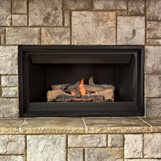 A gas-powered fireplace with a fire blazing